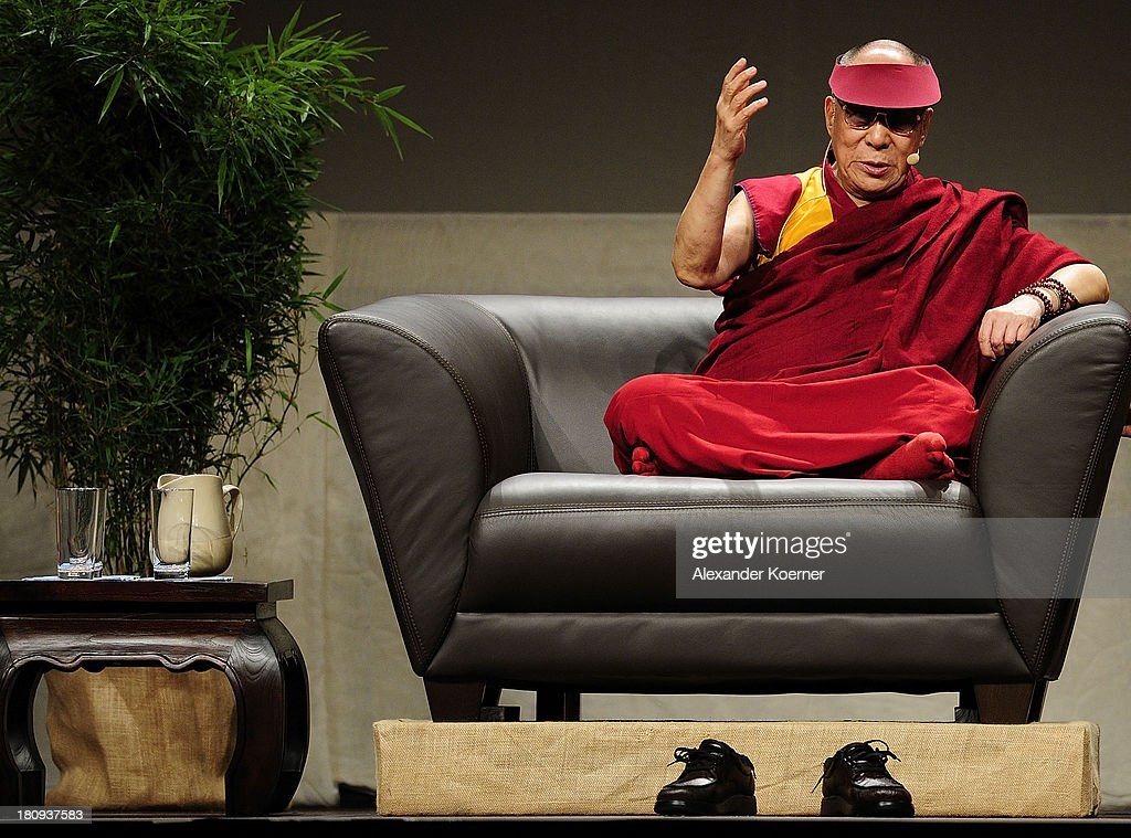 The Dalai Lama during a speech on 'Strength Through Compassion and Tolerance' at the Swiss Life Hall on September 18, 2013 in Hanover, Germany. The Dalai Lama will spend two days in the city of Hanover.
