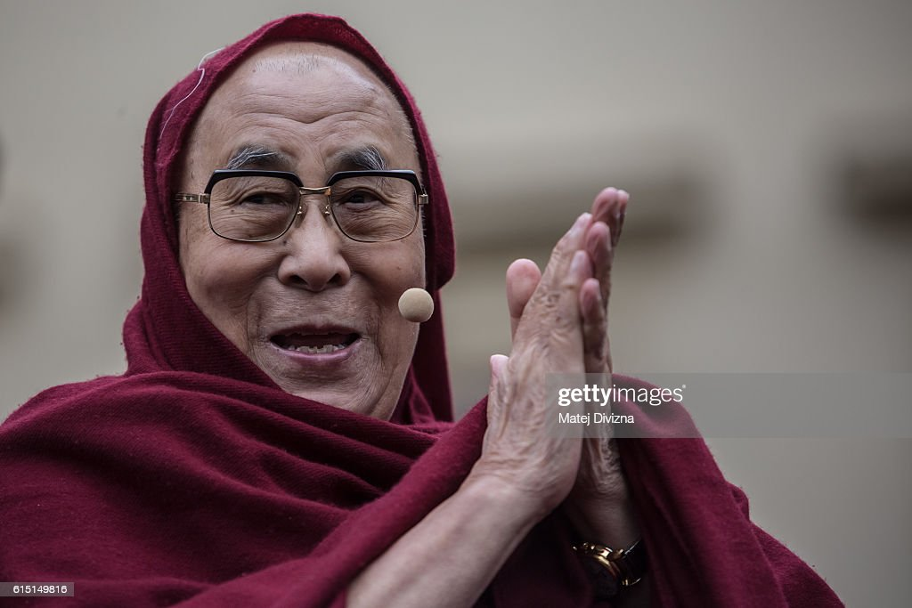 The Dalai Lama gestures as he attends a gathering with his supporters at the Hradcanske Square in front of Prague Castle on October 17, 2016 in Prague, Czech Republic. It is the first stop during his visit to the Czech Republic where he will attend the Forum 2000 Conference.
