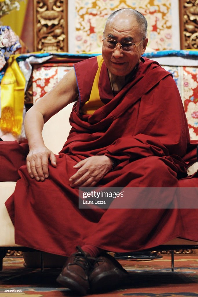 The Dalai Lama gives a public lecture at Modigliani Forum on June 15, 2014 in Livorno, Italy. The two-day meeting in Livorno drew about 10,000 visitors each day to the Forum to see the Dalia Lama explaining texts of Buddhist philosophers and teaching.