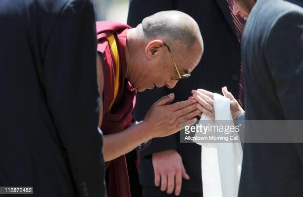 The Dalai Lama greets Dr Alice Gast president of Lehigh University outside of Stabler Arena in Bethlehem Pennsylvania Thursday July 10 2008