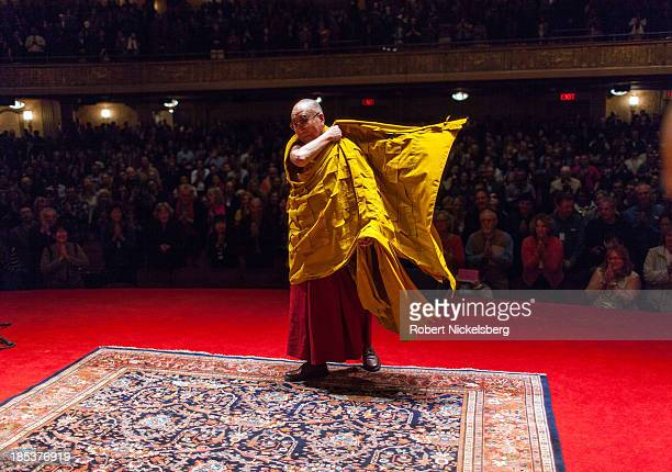 The Dalai Lama greets his audience at the Beacon Theater October 19 2013 in New York City The Dalai Lama is in New York for three days of Buddhist...