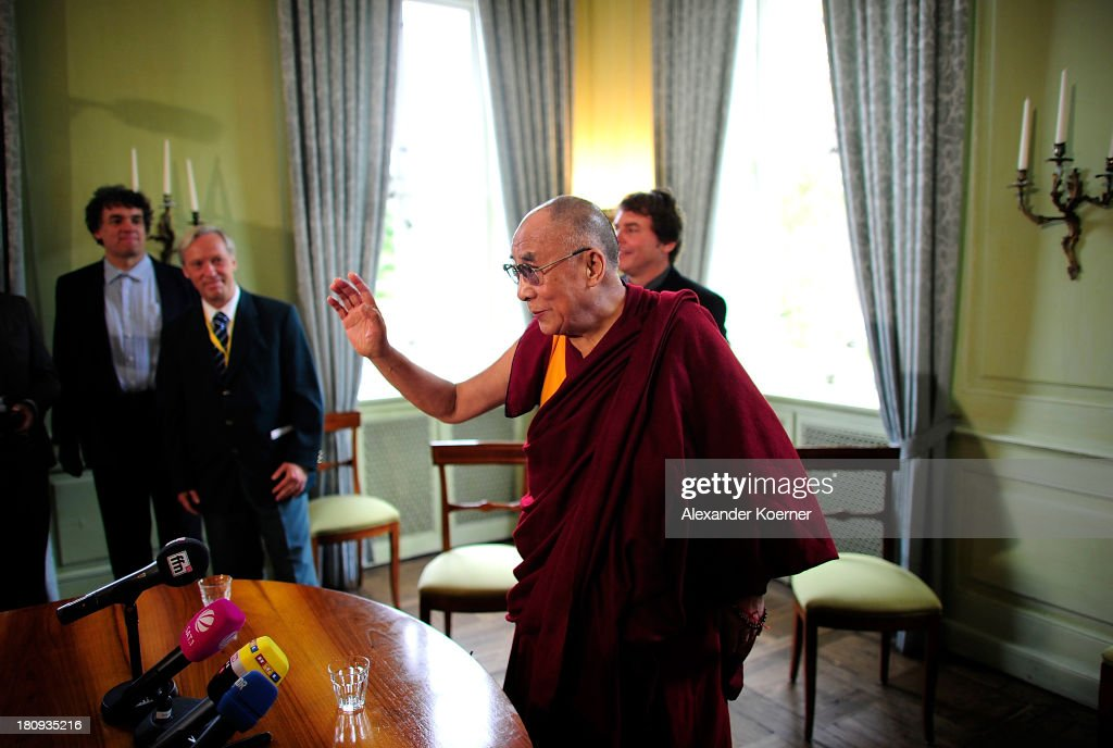 The Dalai Lama greets journalists prior a press conference on September 18, 2013 in Hanover, Germany. Today the Dalai Lama is due to give a public talk on 'Strength Through Compassion and Tolerance', at Swiss Life Hall.