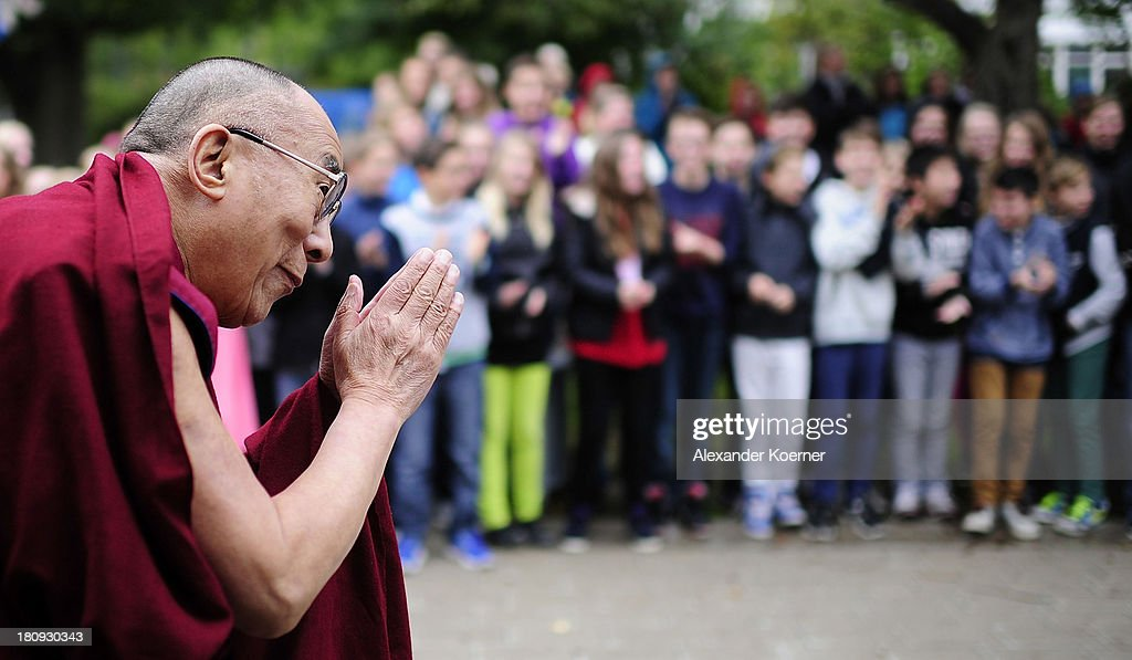 The Dalai Lama greets school children during his visit to the IGS List on September 18, 2013 in Hanover, Germany.