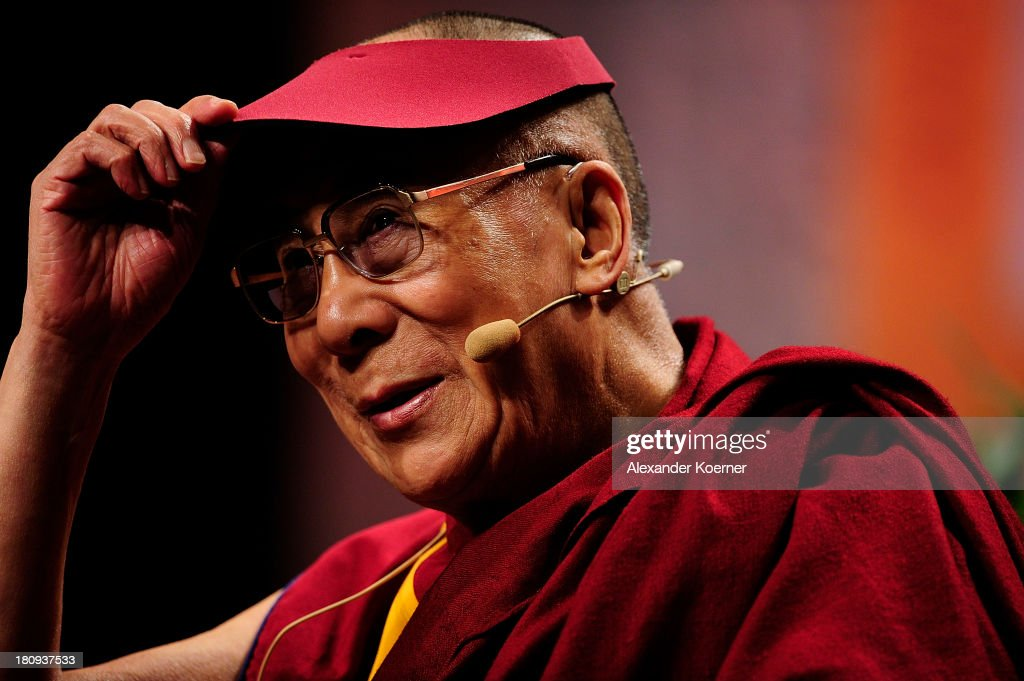 The Dalai Lama greets the public prior to speech on 'Strength Through Compassion and Tolerance' at the Swiss Life Hall on September 18, 2013 in Hanover, Germany. The Dalai Lama will spend two days in the city of Hanover.