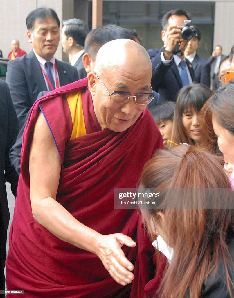 The Dalai Lama greets wellwishers on his arrival at Narita International Airport on November 3, 2012 in Narita, Chiba, Japan. The Tibet's spiritual leader will be on 12 days tour to Japan.