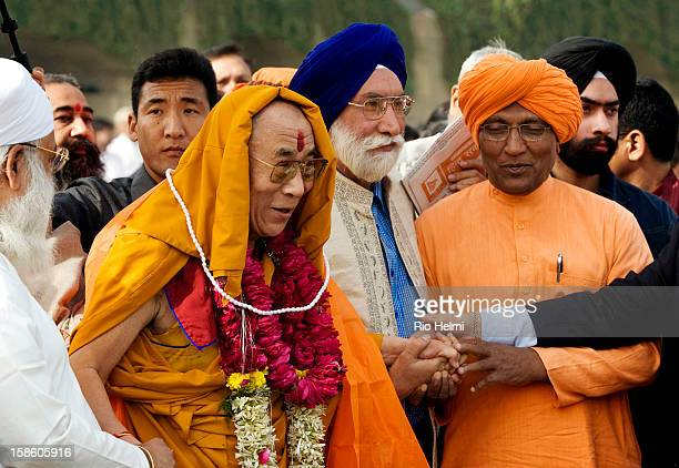 The Dalai Lama in New Dehli is draped in the attributes of various religions after an interfaith prayer meeting for peace in Tibet attended by...
