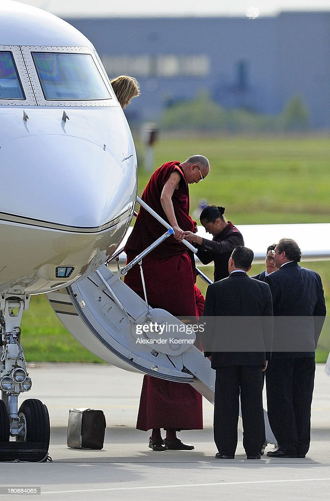 The Dalai Lama is been pictured leaving his private aircraft at Hanover Airport on September 17, 2013 in Hanover, Germany. The Dalai Lama will spend two days in the city of Hanover.