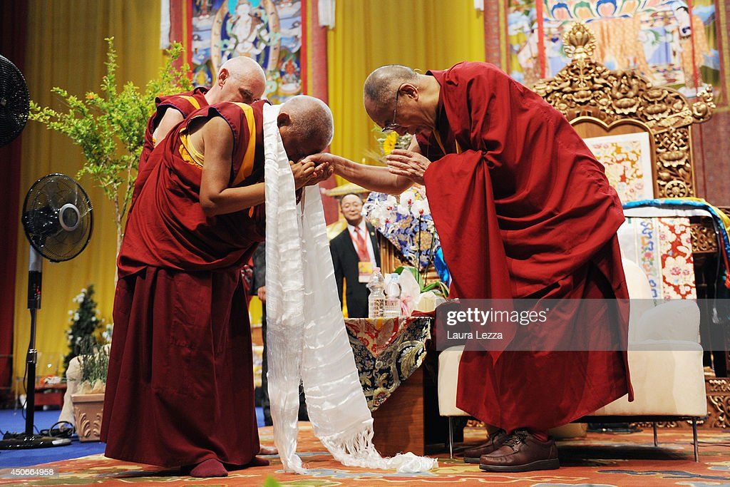 The Dalai Lama is greeted by monks after giving a public lecture at the the Modigliani Forum on June 15, 2014 in Livorno, Italy. The two-day meeting in Livorno drew about 10,000 visitors each day to the Forum to see the Dalia Lama explaining texts of Buddhist philosophers and teaching.