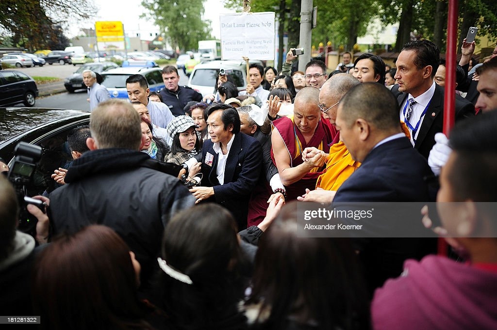 The Dalai Lama leaves after speaking to his supporters at the Vien-Giac Pagoda monastery on September 20, 2013 in Hanover, Germany. His Holiness will travel next to India.