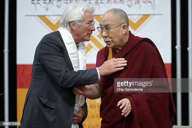 The Dalai Lama listens to actor Richard Gere after addressing followers and supporters during an event at the Bender Arena on the campus of American...