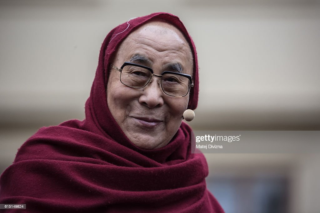 The Dalai Lama looks on as he attends a gathering with his supporters at the Hradcanske Square in front of Prague Castle on October 17, 2016 in Prague, Czech Republic. It is the first stop during his visit to the Czech Republic where he will attend the Forum 2000 Conference.