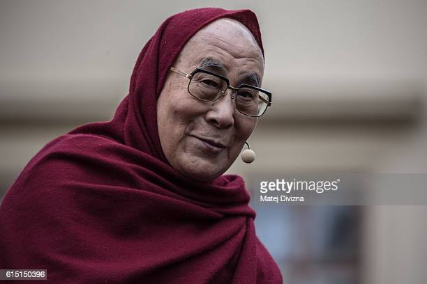The Dalai Lama looks on as he attends a gathering with his supporters at the Hradcanske Square in front of Prague Castle on October 17 2016 in Prague...