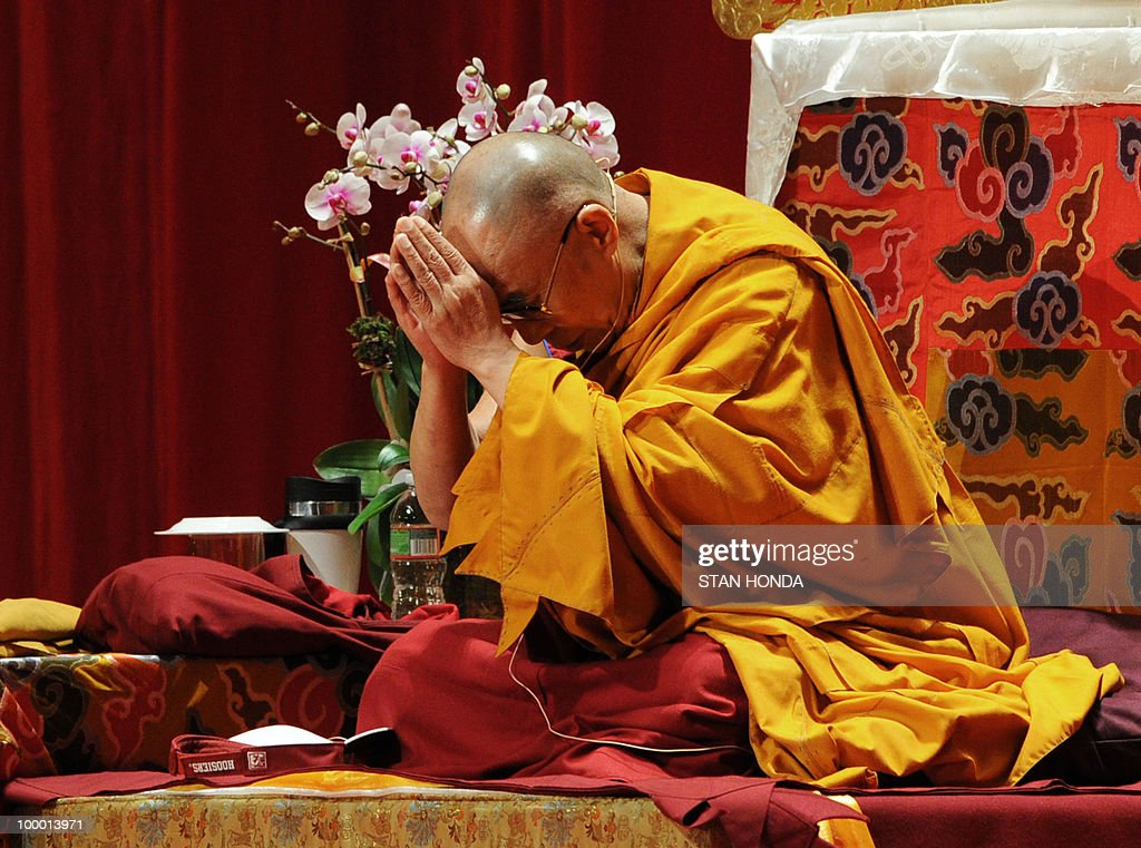 The Dalai Lama meditates during the first of his teaching sessions May 20, 2010 at Radio City Hall in New York. The Dalai Lama is on a four-day visit to New York. AFP PHOTO/Stan Honda