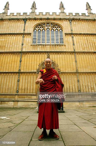 The Dalai Lama poses for photographs during a photocall in Oxford on May 30 2008 The Dalai Lama on Friday winds up his British tour which was hit by...