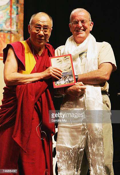 The Dalai Lama poses with Andrew Crowe the author of the book 'The Dalai Lama's Story' at the Vector Arena on June 17 2007 in Auckland New Zealand...