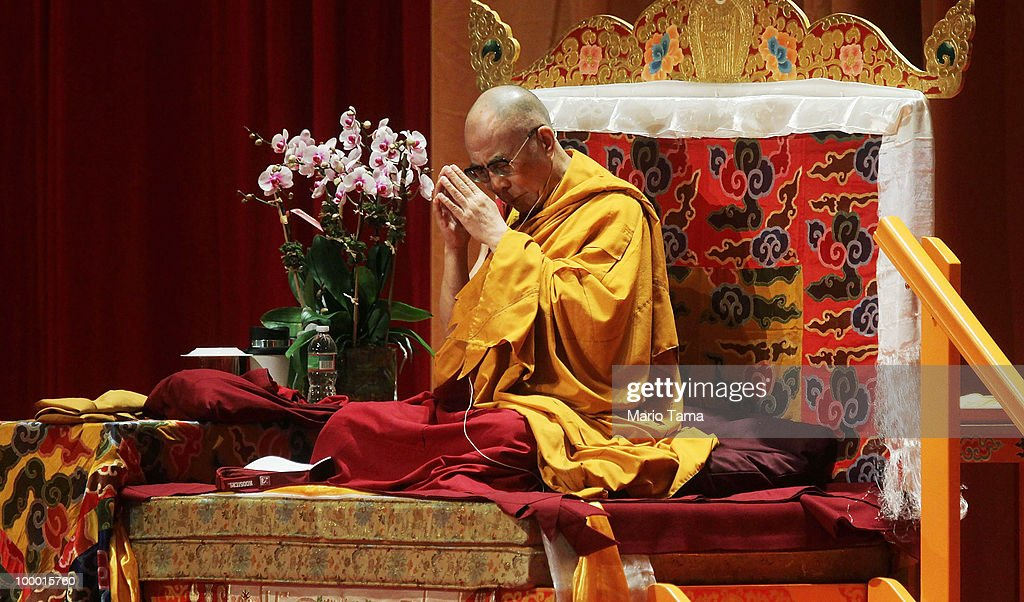 The Dalai Lama prays while delivering a teaching at Radio City Music Hall May 20, 2010 in New York City. The Tibetan spiritual leader will deliver three days of teachings at Radio City followed by an interfaith dialogue at the Church of St. John the Divine on Sunday.