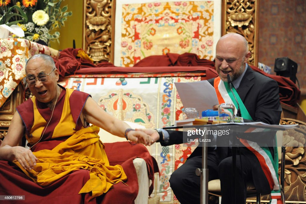 The Dalai Lama receives honorary citizenship and the key to the city of Livorno from the newly elected Mayor of Livorno Filippo Nogarin at Modigliani Forum on June 14, 2014 in Livorno, Italy. The event held this morning in Livorno drew almost 8000 visitors to the Forum alone to see the Dalia Lama finally receive his honorary citizenship from the Italian city twenty years after it was first awarded to him in 1994 by former Livorno Mayor Gianfranco Lamberti.
