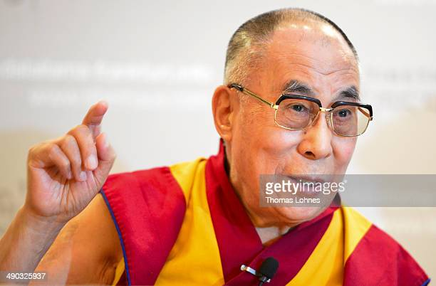 The Dalai Lama speaks during a press conference while supporters of the International Shugden Community protest outside against the current visit of...