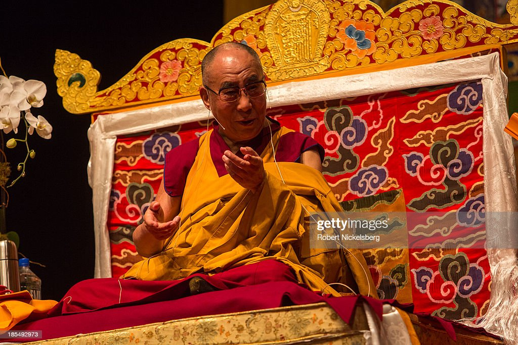 The Dalai Lama speaks to the audience during an initiation ceremony at the Beacon Theater October 20, 2013 in New York City. The Dalai Lama is in New York City for three days of his Buddhist teachings that run October 18-20. The teachings are supported by the Richard Gere Foundation.