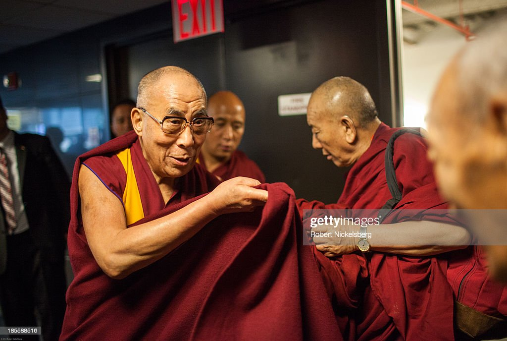 The Dalai Lama speaks with Khyongla Rato Rinpoche (R) before being escorted to his plane leaving for Germany October 21, 2013 at JFK Airport in New York City. The Dalai Lama was in New York City for three days of his Buddhist teachings that ran October 18-20.