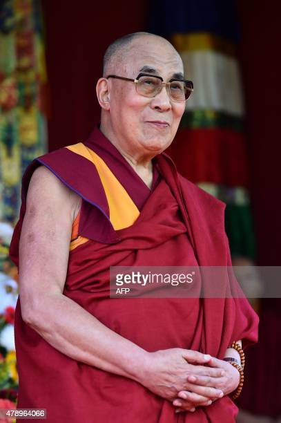 The Dalai Lama takes to the stage to address the faithful in Aldershot on June 29 2015 which has a large Nepalese Buddhist community made up mainly...