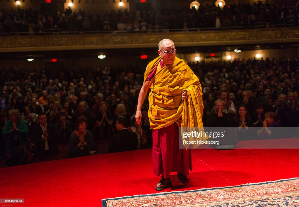 The Dalai Lama walks to his speaking platform during an initiation ceremony at the Beacon Theater October 20, 2013 in New York City. The Dalai Lama is in New York City for three days of his Buddhist teachings that run October 18-20. The teachings are supported by the Richard Gere Foundation.