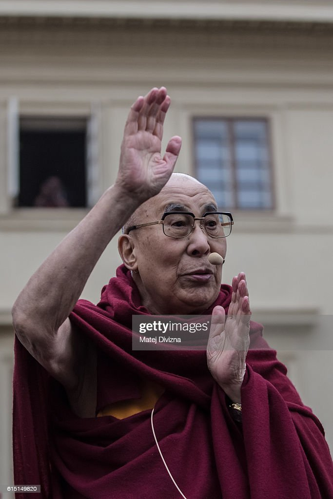 The Dalai Lama waves as he attends a gathering with his supporters at the Hradcanske Square in front of Prague Castle on October 17, 2016 in Prague, Czech Republic. It is the first stop during his visit to the Czech Republic where he will attend the Forum 2000 Conference.