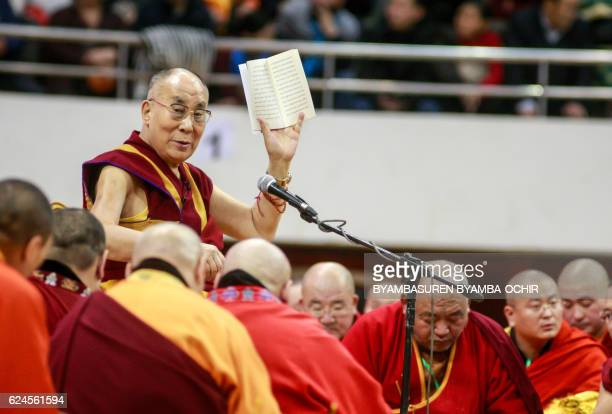 The Dalai Lama waves to worshippers during ceremonies at the Buyant Ukhaa sports stadium in Ulan Bator the capital of Mongolia on November 20 2016...