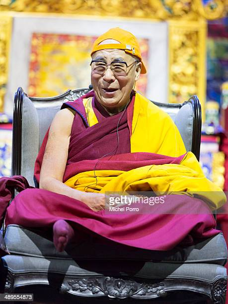 The Dalai Lama wears a cap with the Dutch national color orange on the second day of his threeday visit on May 11 2014 in Rotterdam Netherlands
