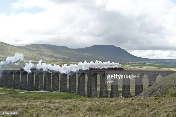 The Dalesman steam train crosses the 24 arch Ribblehead Viaduct erected in 1875 in the Yorkshire Dales national park near Ingleton northern England...