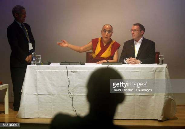 The Dalia Lama gives a press conference with Victor Spence from the Inter faith group during a visit to the National Library of Scotland in Edinburgh...