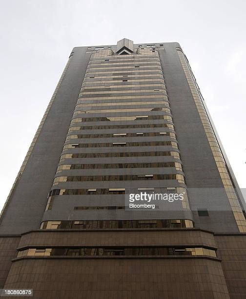 The Dalian Wanda Group headquarters stands in Dalian China on Saturday Sept 14 2013 Goldman Sachs Group Inc this month raised its estimate for...