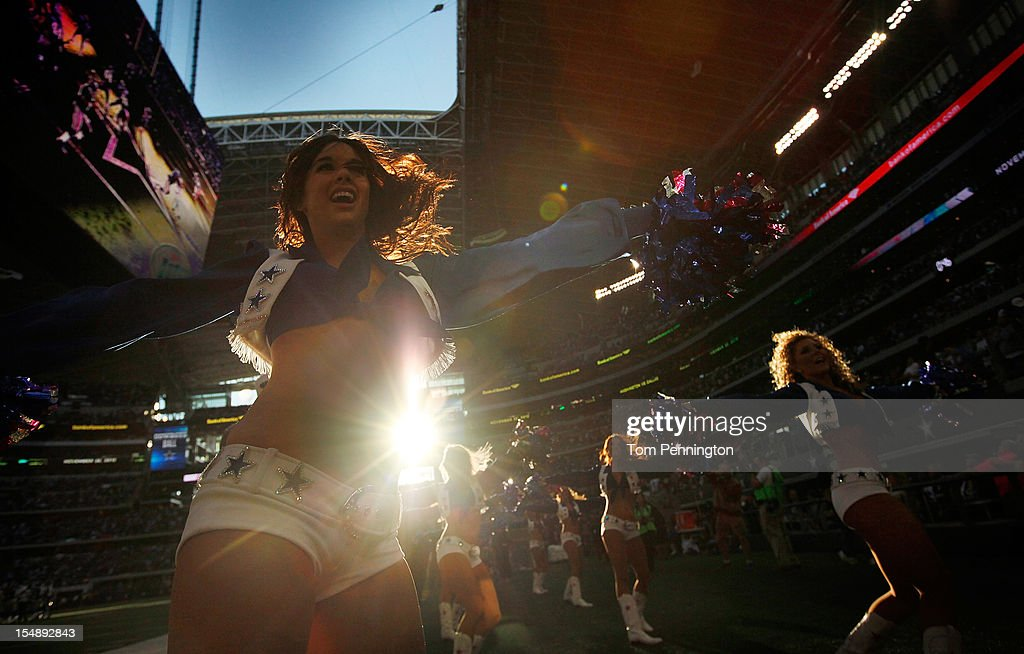 The Dallas Cowboys cheerleaders cheer on their team against the New York Giants at Cowboys Stadium on October 28, 2012 in Arlington, Texas. The New York Giants beat the Dallas Cowboys 29-26.