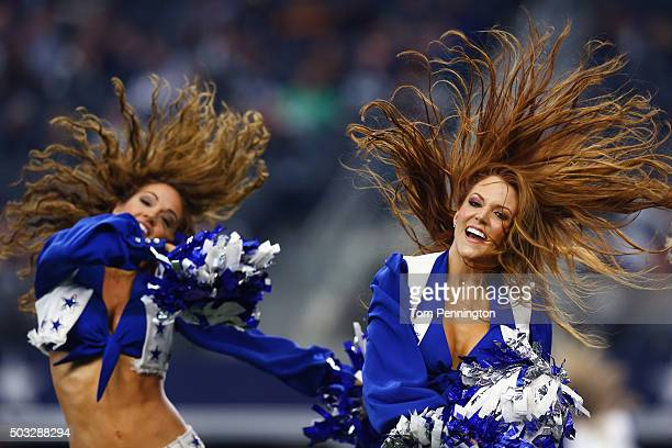 The Dallas Cowboys Cheerleaders perform as the Dallas Cowboys take on the Washington Redskins in the fourth quarter on January 3 2016 in Arlington...