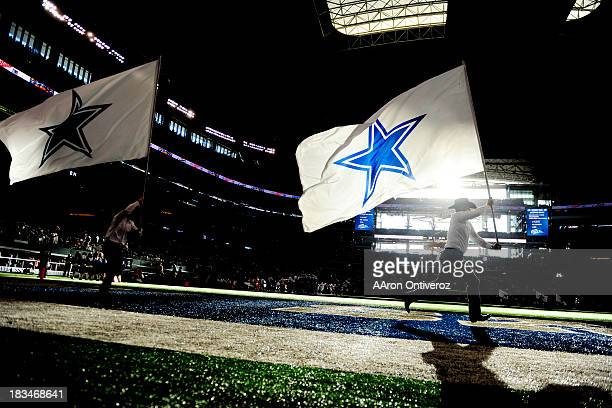 The Dallas Cowboys flag crew waives the team banner after scoring a touchdown against the Denver Broncos during the second half of the Broncos' 5148...