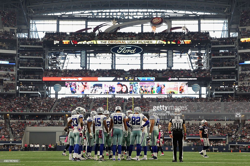 The Dallas Cowboys huddle up during the second half of the NFL game against the New England Patriots at ATT Stadium on October 11 2015 in Arlington...