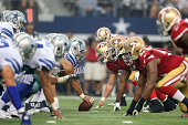 the Dallas Cowboys offense lines up against the San Francisco 49ers defense in the first half at ATT Stadium on September 7 2014 in Arlington Texas
