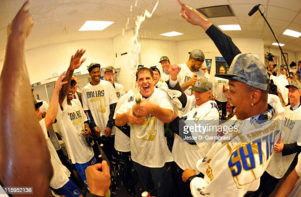 The Dallas Mavericks celebrate after winning the NBA Championship by defeating the Miami Heat during Game Six of the 2011 NBA Finals on June 12 2011...