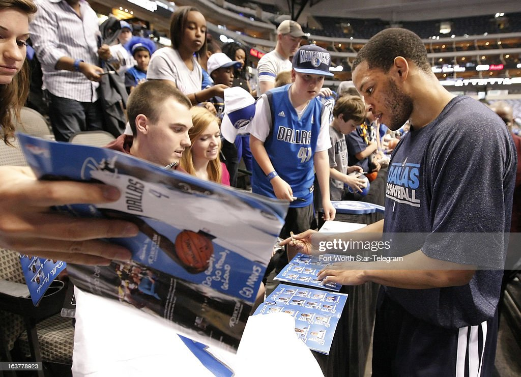 The Dallas Mavericks' Chris Wright signs autographs for fans before the start of action against the Cleveland Cavaliers at American Airlines Center in Dallas, Texas on Friday, March 15, 2013. Wright is the first player with multiple sclerosis to play in the NBA; the Mavericks signed him to a 10-day contract.
