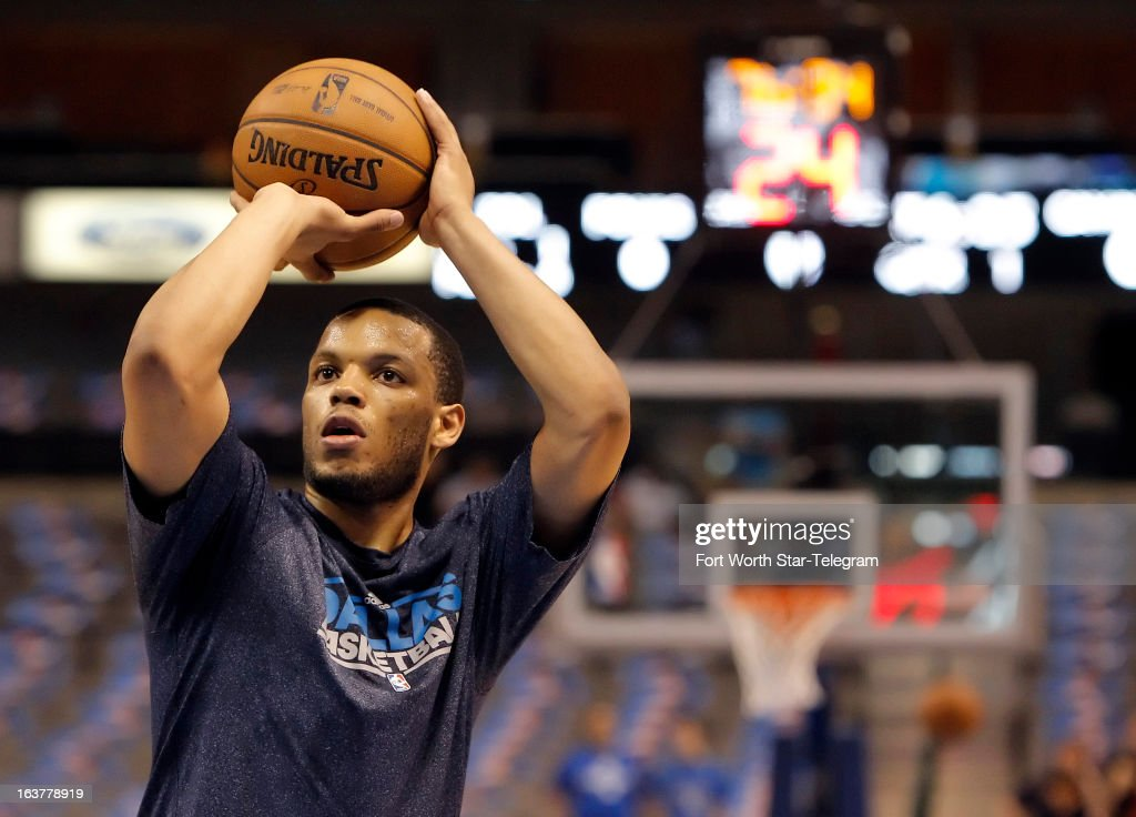 The Dallas Mavericks' Chris Wright warms up before the start of action against the Cleveland Cavaliers at American Airlines Center in Dallas, Texas on Friday, March 15, 2013. Wright is the first player with multiple sclerosis to play in the NBA; the Mavericks signed him to a 10-day contract.