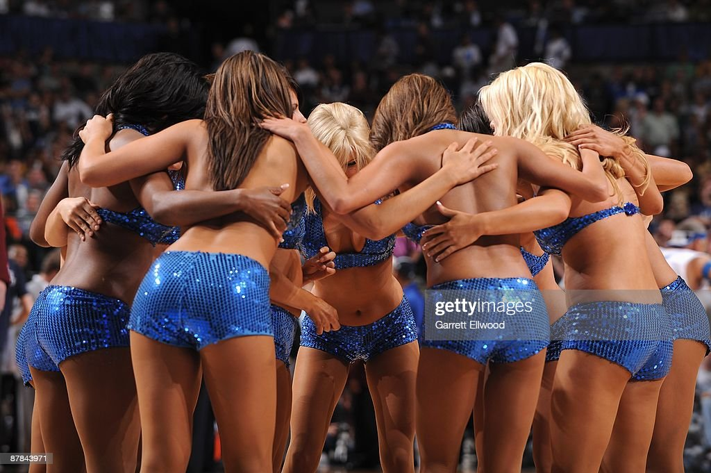 The Dallas Mavericks dance team huddles on the court during a break in Game Four of the Western Conference Semifinals against the Denver Nuggets during the 2009 NBA Playoffs at the American Airlines Center on May 11, 2009 in Dallas, Texas. The Mavericks won 119-117.