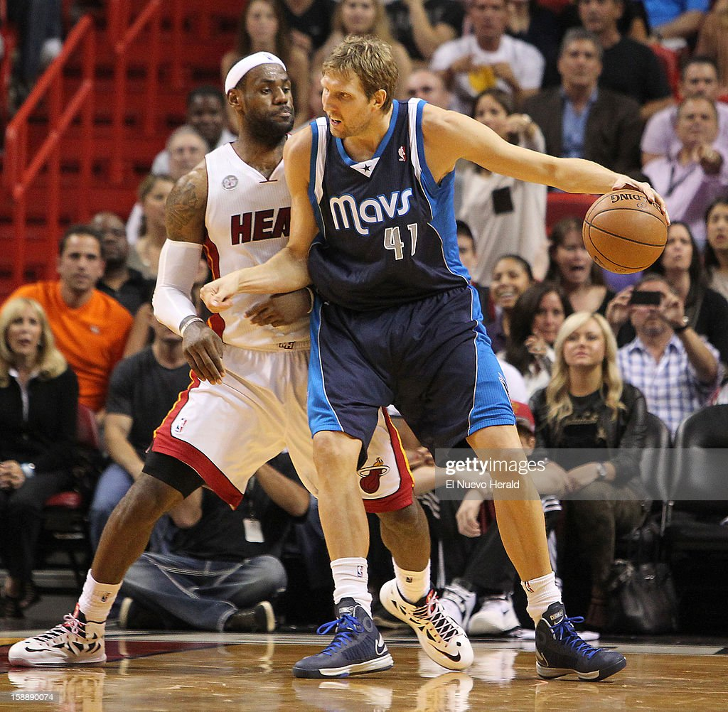 The Dallas Mavericks' Dirk Nowitzki, right, drives against the Miami Heat's LeBron James in the fourth quarter at the AmericanAirlines Arena in Miami, Florida, on Wednesday, January 2, 2013. The Heat won, 119-109, in overtime.