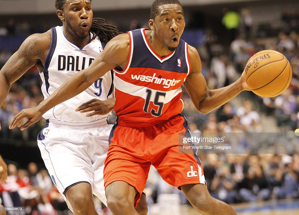 The Dallas Mavericks' Jae Crowder (9) pressures the Washington Wizards' Jordan Crawford (15) in the second half at the American Airlines Center in Dallas, Texas, on Wednesday, November 14, 2012. Dallas defeated Washington, 107-101.