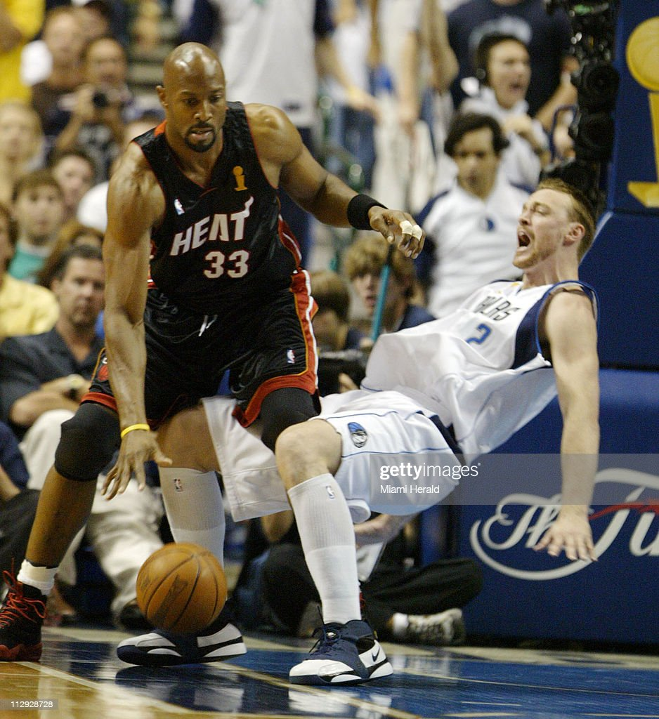 The Dallas Mavericks Keith Van Horn right takes a fall but s