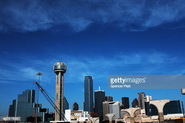 The Dallas skyline is viewed on February 6 2015 in Dallas Texas As crude oil prices have fallen nearly 60 percent globally many American communities...