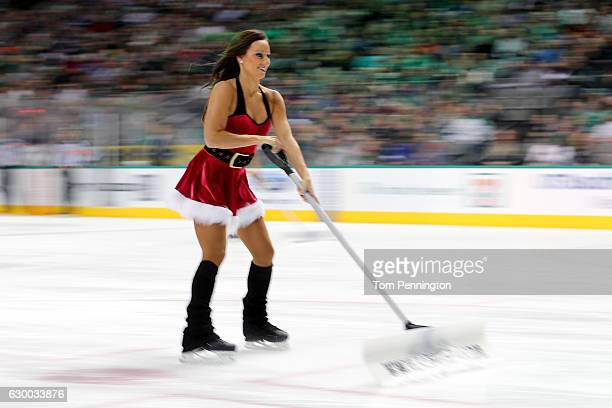 The Dallas Stars Ice Girls clear the ice as the Dallas Stars take on the New York Rangers at American Airlines Center on December 15 2016 in Dallas...