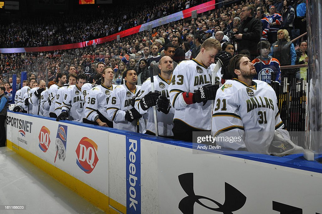The Dallas Stars stand for the singing of the national anthem prior to a game against the Edmonton Oilers on February 6, 2013 at Rexall Place in Edmonton, Alberta, Canada.
