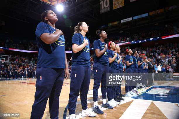 The Dallas Wings stand for the National Anthem before the game against the Connecticut Sun on August 12 2017 at Mohegan Sun Arena in Uncasville CT...