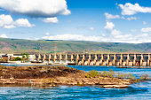 The Dalles Dam spanning the Columbia River construction began in 1952 and went into operation in 1957 where it flooded Celilo Falls, and a native settlement named Celilo after the falls.