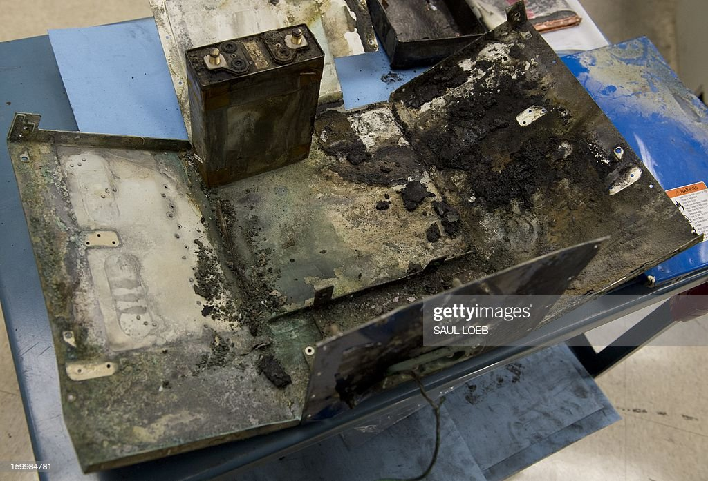 The damaged battery case from a fire aboard a Japan Airlines (JAL) Boeing 787 Dreamliner airplane at Logan International Airport in Boston earlier this month is displayed inside an investigation lab at National Transportation Safety Board (NTSB) Headquarters in Washington, DC, on January 24, 2013. The state-of-the-art composite aircraft continues to be grounded as the investigation into the cause of the thermal damage continues. AFP PHOTO / Saul LOEB